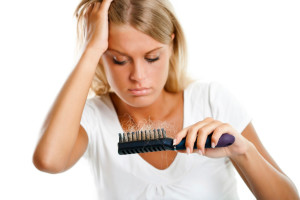 Выпадение волос у женщин причины